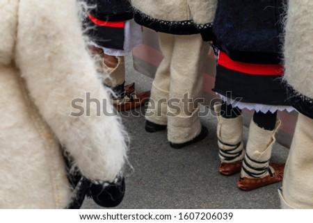 Sighetu Marmatiei, Romania: Maramures traditional costumes. Traditional Romanian peasant sandals which is worn with the Romanian peasant costume at Winter Customs and Traditions Marmatia Festival #1607206039