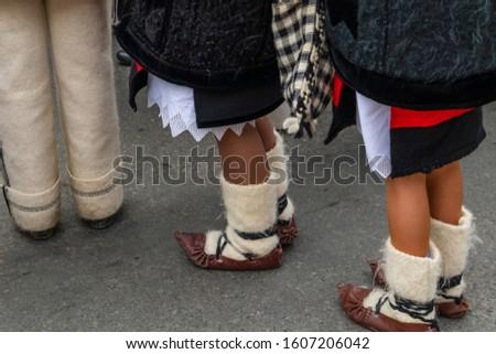 Sighetu Marmatiei, Romania: Maramures traditional costumes. Traditional Romanian peasant sandals which is worn with the Romanian peasant costume at Winter Customs and Traditions Marmatia Festival #1607206042