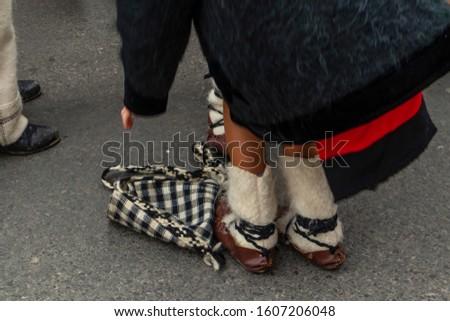 Sighetu Marmatiei, Romania: Maramures traditional costumes. Traditional Romanian peasant sandals which is worn with the Romanian peasant costume at Winter Customs and Traditions Marmatia Festival #1607206048