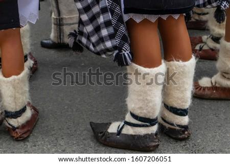 Sighetu Marmatiei, Romania: Maramures traditional costumes. Traditional Romanian peasant sandals which is worn with the Romanian peasant costume at Winter Customs and Traditions Marmatia Festival #1607206051