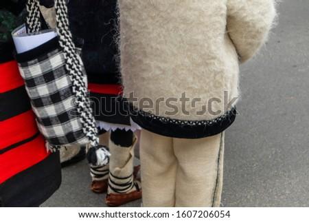 Sighetu Marmatiei, Romania: Maramures traditional costumes. Traditional Romanian peasant sandals which is worn with the Romanian peasant costume at Winter Customs and Traditions Marmatia Festival #1607206054