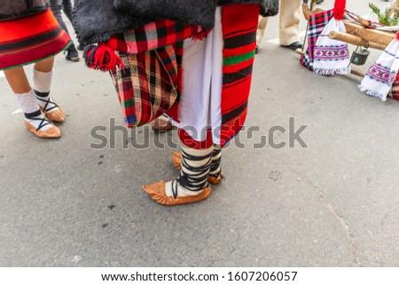 Sighetu Marmatiei, Romania: Maramures traditional costumes. Traditional Romanian peasant sandals which is worn with the Romanian peasant costume at Winter Customs and Traditions Marmatia Festival #1607206057