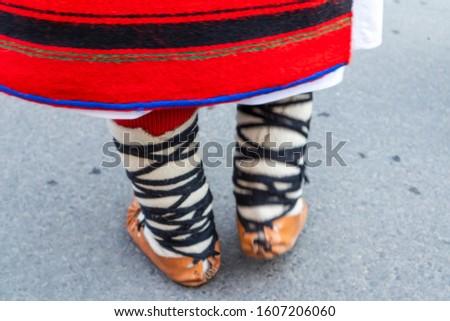 Sighetu Marmatiei, Romania: Maramures traditional costumes. Traditional Romanian peasant sandals which is worn with the Romanian peasant costume at Winter Customs and Traditions Marmatia Festival #1607206060