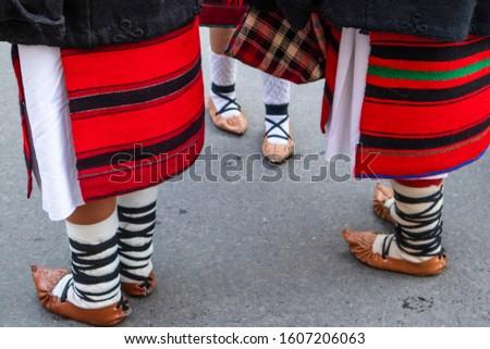 Sighetu Marmatiei, Romania: Maramures traditional costumes. Traditional Romanian peasant sandals which is worn with the Romanian peasant costume at Winter Customs and Traditions Marmatia Festival #1607206063