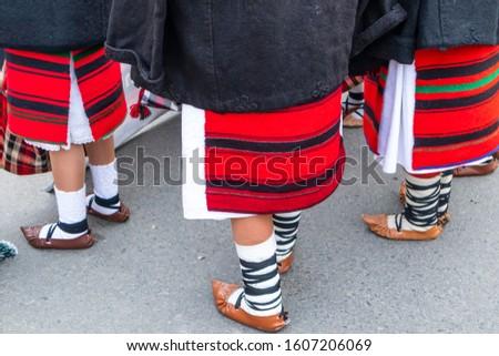 Sighetu Marmatiei, Romania: Maramures traditional costumes. Traditional Romanian peasant sandals which is worn with the Romanian peasant costume at Winter Customs and Traditions Marmatia Festival #1607206069