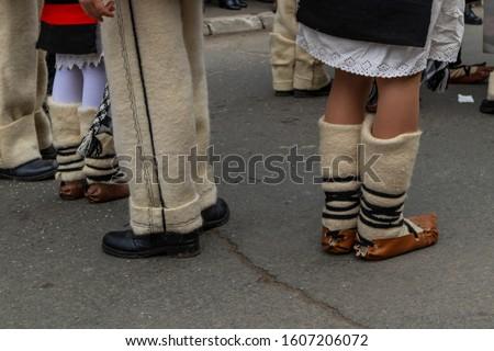 Sighetu Marmatiei, Romania: Maramures traditional costumes. Traditional Romanian peasant sandals which is worn with the Romanian peasant costume at Winter Customs and Traditions Marmatia Festival #1607206072
