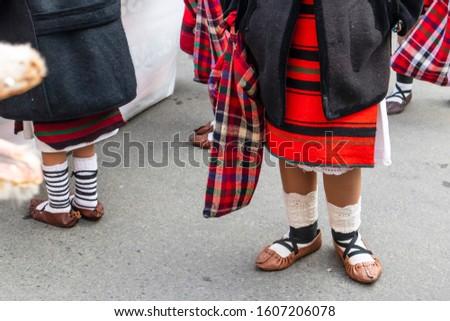 Sighetu Marmatiei, Romania: Maramures traditional costumes. Traditional Romanian peasant sandals which is worn with the Romanian peasant costume at Winter Customs and Traditions Marmatia Festival #1607206078