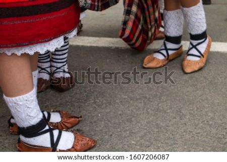 Sighetu Marmatiei, Romania: Maramures traditional costumes. Traditional Romanian peasant sandals which is worn with the Romanian peasant costume at Winter Customs and Traditions Marmatia Festival #1607206087