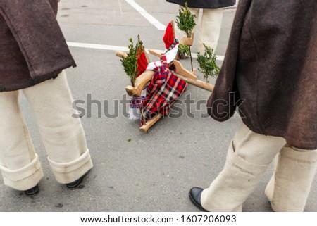 Sighetu Marmatiei, Romania: Maramures traditional costumes. Traditional Romanian peasant sandals which is worn with the Romanian peasant costume at Winter Customs and Traditions Marmatia Festival #1607206093