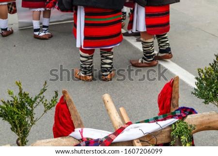 Sighetu Marmatiei, Romania: Maramures traditional costumes. Traditional Romanian peasant sandals which is worn with the Romanian peasant costume at Winter Customs and Traditions Marmatia Festival #1607206099