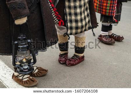 Sighetu Marmatiei, Romania: Maramures traditional costumes. Traditional Romanian peasant sandals which is worn with the Romanian peasant costume at Winter Customs and Traditions Marmatia Festival #1607206108