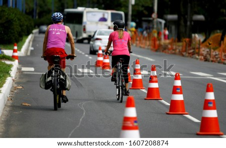 salvador, bahia / brazil - august 10, 2014: cyclist uses bike lane in the neighborhood of Itaigara in Salvador, reserved for physical activities on weekends. #1607208874