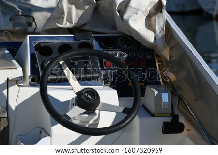 a steering wheel in a ship in the port of Altea, Alicante Province, Costa Blanca, Spain, January 5, 2020 #1607320969