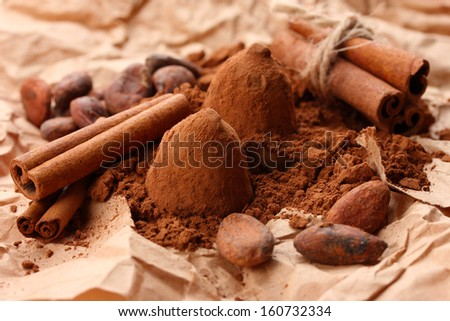 Composition of chocolate  truffles, cocoa and spices on brown background #160732334