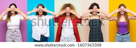 Set of women over isolated colorful background covering eyes by hands #1607363308