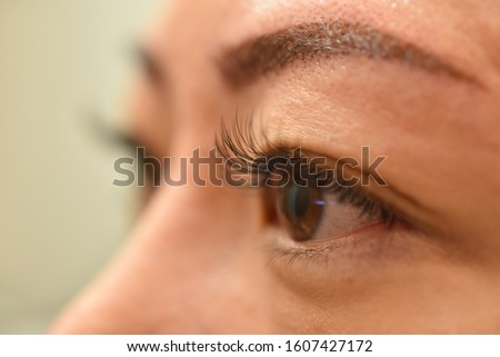 Asian woman got Eyelash Extension Service from skilled professional Lash Stylist to enhance length, curliness, fullness, and thickness of natural eyelashes. Fake lash applied one at a time using glue