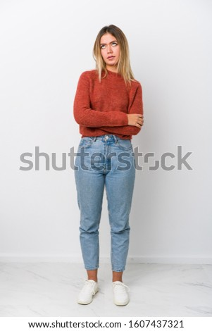 Full body young caucasian woman tired of a repetitive task. #1607437321