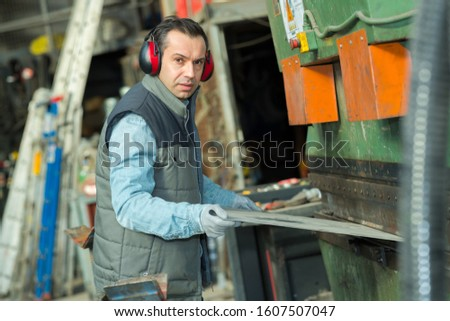 portrait of worker in cement plant #1607507047