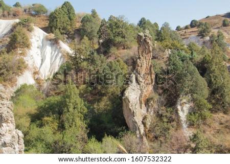 """Rock weathering cliffs of The Western Tien Shan""""s Akshuran mountain pass in Uzbekistan. #1607532322"""