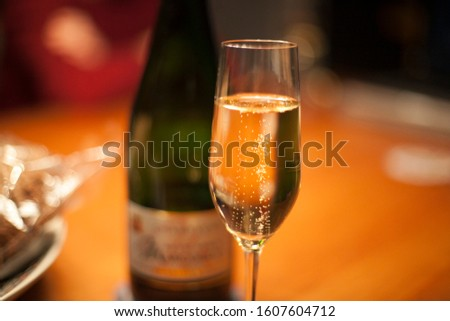 A glass of champagne bubbling away on New Year's Eve.  #1607604712