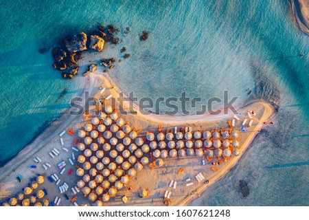 Aerial drone shot of beautiful turquoise beach with pink sand Elafonissi, Crete, Greece. Best beaches of Mediterranean, Elafonissi beach, Crete, Greece. Famous Elafonisi beach on Greece island, Crete. #1607621248