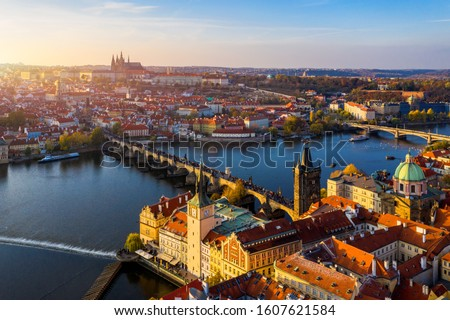 Aerial Prague panoramic drone view of the city of Prague at the Old Town Square, Czechia. Prague Old Town pier architecture and Charles Bridge over Vltava river in Prague at sunset, Czech Republic.  #1607621584