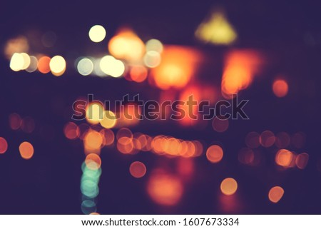 Blurred images of the background party in the festive festivities during the night, consisting of people and glittering bokeh. #1607673334