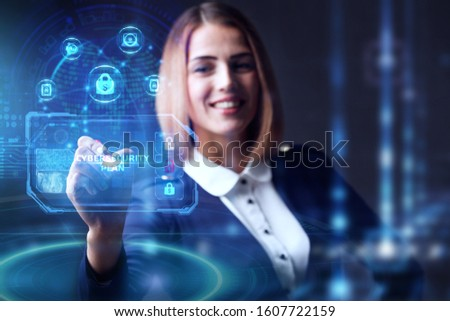Business, technology, internet and networking concept. Young businessman working  in the office, select the icon CYBERSECURITY PLAN on the virtual display. Royalty-Free Stock Photo #1607722159