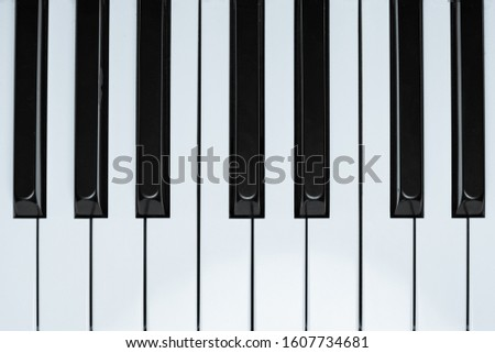 View of a nice wooden upright piano  #1607734681
