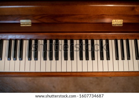 View of a nice wooden upright piano  #1607734687