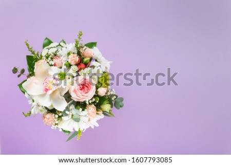 Flower bouquet with gift boxes on purple background with copy space. Flat lay, top view floral Valentine's Day or Mother's Day concept #1607793085