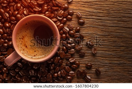 cup of coffee with coffee beans on grunge wooden background. #1607804230