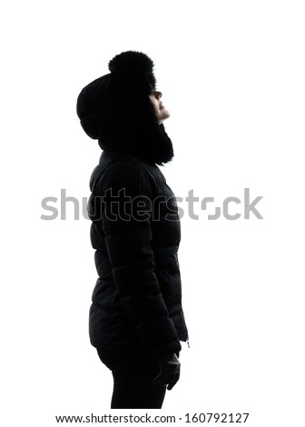 one  woman in winter coat looking up serious silhouette on white background #160792127