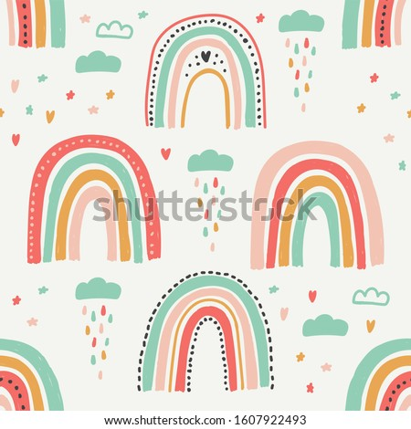 Cute scandinavian childish seamless pattern with trendy hand drawn rainbows in naive art style, can be used as kids texture for fabrics, textile, wallpaper, apparel etc #1607922493