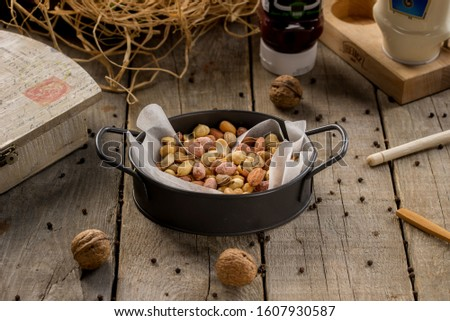 plate of assorted fresh assorted nuts #1607930587
