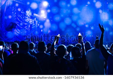 music concert at night on the street, youth dancing and applauding, blue background #1607936536