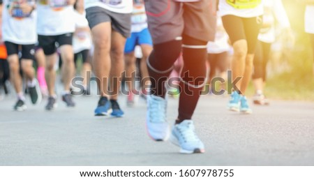 Motion blur of Marathon running #1607978755