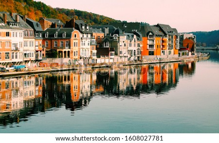 A beautiful photo of houses near water body #1608027781