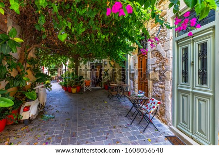 Street in the old town of Chania, Crete, Greece. Charming streets of Greek islands, Crete. Beautiful street in Chania, Crete island, Greece. Summer landscape. Chania old street of Crete island Greece. #1608056548