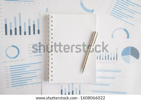 Business document report data with bar charts, pie charts, line graphs, on paper. Research data for market analysis and corporate financial planning. #1608066022