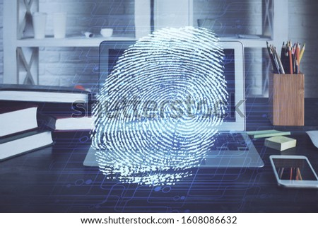 Computer on desktop in office with finger print drawing. Double exposure. Concept of business data security. #1608086632
