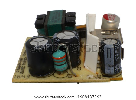 Electronic devices in a 220V AC to 5V DC adapter in a white background #1608137563