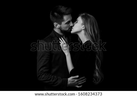 elegant couple in the tender passion. man and beautiful woman kissing. black and white #1608234373