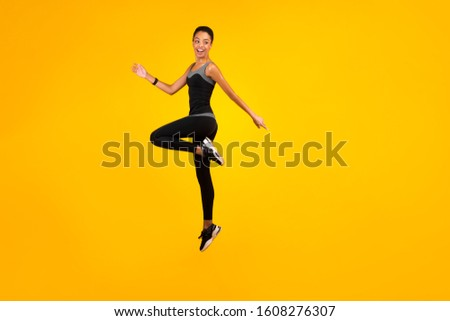 Fitness Concept. Afro Lady Jumping Exercising In Studio On Yellow Background. Copy Space, Full Length #1608276307