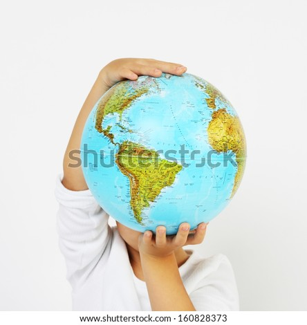 Standing child boy holding a globe in hands in front of his head on white background #160828373