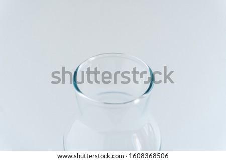 Blurred glass bottleneck at gray monochrome background. Zero waste storage. Minimalist lifestyle. Copy space. #1608368506