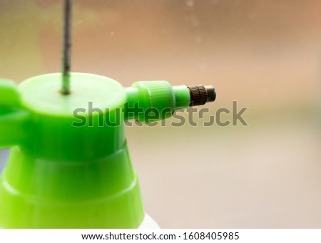 water sprayer with green top #1608405985