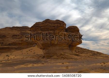 Face in the rock at Mada'in Saleh (Al-Ḥijr & Hegra) archaeological site near Al Ula, Saudi Arabia #1608508720