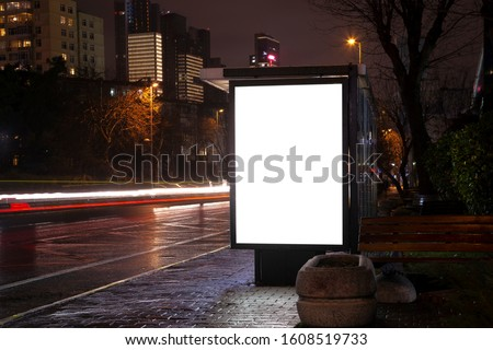 Blank billboard on night street