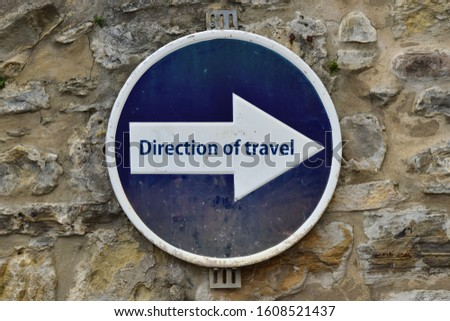 Street sign saying: Direction of travel #1608521437